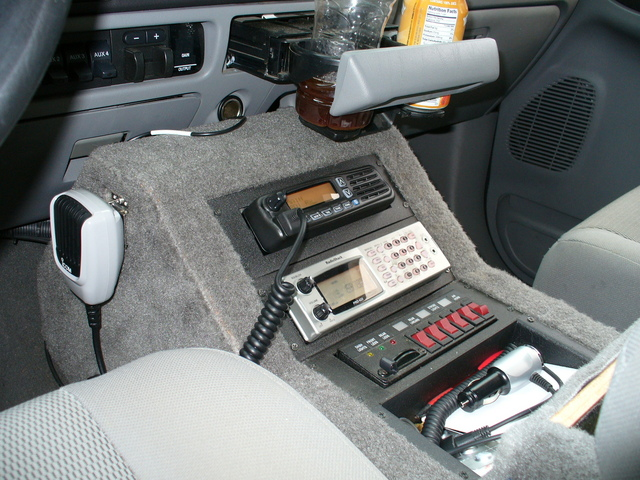 Icom F5061 mounted in center console, wired to center antenna.